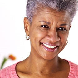 older woman smiling with nice teeth