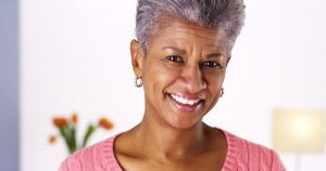older woman smiling grey hair