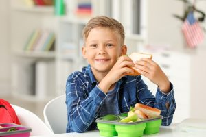 "As a parent, you're always concerned about every aspect of your kids' wellbeing, which includes their food intake. To ensure they get the nutrients needed to function well and be as healthy as possible, you may choose to prepare their lunch at home instead of relying on their school's cafeteria. With your busy life, you need some simple food ideas that will support their oral health instead of act as a hinderance. To help you out, a children's dentist in Temple has some effective suggestions! <!—more--> Try Breakfast for Lunch If your kids are like most children, often, breakfast meals can be a ""hit"" for lunch or dinner. If you're pushed for time, you can simply boil a few eggs and pack some fresh fruit and yogurt. This will provide your children with a protein-rich meal that will fortify their oral health and encourage their continued development.  Create Your Own Variety Pack Most kids love pre-packaged meal-snacks like Lunchables. The problem with such products is that they are usually loaded with preservatives that can have long-term health effects and contribute to poor oral health.  To generate the same excitement and sense of discovery that comes along with having a snack-pack, you can make your own variety box. You can look for a lunch box or Tupperware with small compartments that can hold different items to satisfy your children's sense of adventure. Grill Some Lunch Kebabs If you're looking for an excuse to break out the grill a little early, then preparing kebabs for the kiddos is a good one. On a single skewer, you can place protein (meat) and assorted vegetables. What's even better is that this provides another way to save time while having the peace-of-mind of knowing that your children are eating healthy food that has been made with love. Prepare Soup and Salad A way to get your kids to eat healthy vegetables is to put them in a batch of soup. This will remove the visual and taste barriers that could get in the way. That's because the soup will mask and perfectly marry the different flavors to make for a delicious and nutritious meal. Then, as long as they're able to use their favorite dressing, many kids will eat a salad. By packing a small one to go along with their lunch, you'll know that they're getting even more key nutrients. Coming up with food solutions for your children simply takes a little creativity and strategizing. The good news is that the efforts you put forth today will pay-off majorly in fortifying their oral health tomorrow! About the Author For over 20 years, Dr. Richard Fossum has been providing dental health solutions for family members of all ages. The University of Texas Dental Branch in Houston graduate not only meets the comprehensive needs of his patients; he also offers expert guidance to help them experience the absolute best in dental health. Dr. Fossum provides personalized and effective dentistry at Fossum Dental Group, and he can be reached for more information through his website."