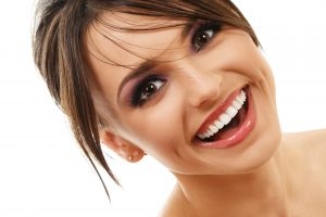 attractive young woman smiling showing bright white teeth