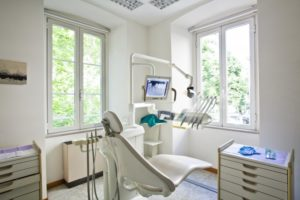Temple dentist office and dental chair prepared for patient in COVID-19