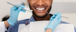 man receiving care from dentist in Temple