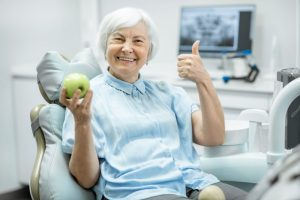 older woman visits dentist in Temple